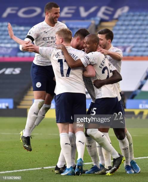 Benjamin Mendy of Manchester City celebrates with teammates Kyle Walker, Kevin De Bruyne, Fernandinho and Ruben Dias after scoring their team's first...
