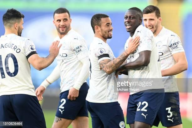 Benjamin Mendy of Manchester City celebrates with teammates Sergio Aguero, Kyle Walker, Gabriel Jesus and Ruben Dias after scoring their team's first...