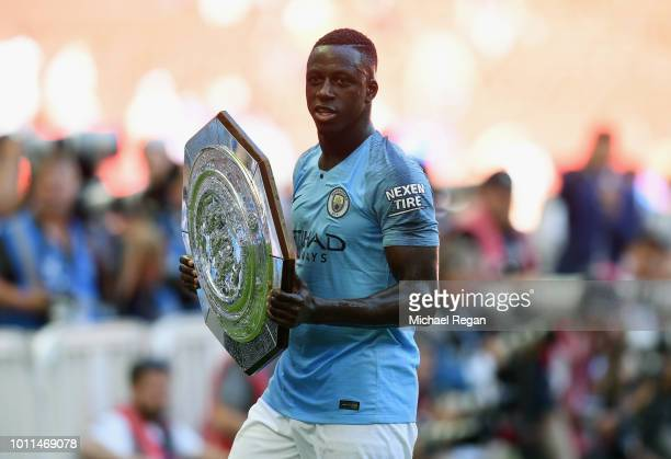 Benjamin Mendy of Manchester City celebrates with the Community Shield trophy following his side's victory during the FA Community Shield between...