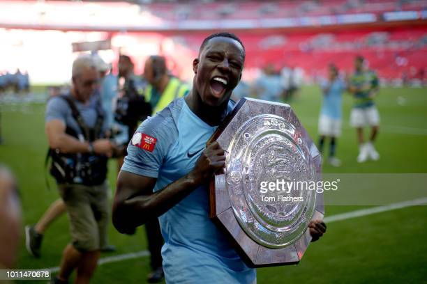 Benjamin Mendy of Manchester City celebrates with the FA Community Shield trophy following his team's victory in the FA Community Shield between...