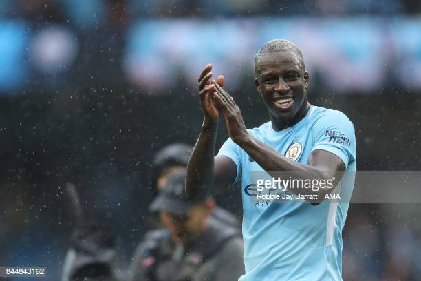 Benjamin Mendy of Manchester City celebrates with the fans at full time during the Premier League match between Manchester City and Liverpool at...