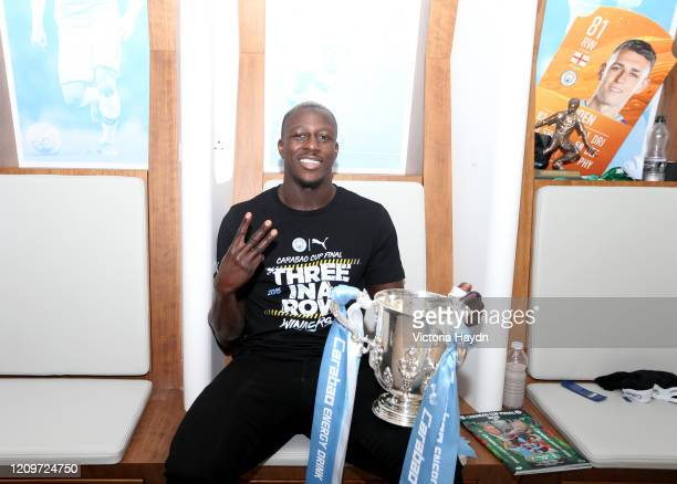 Benjamin Mendy of Manchester City celebrates with the trophy in the changing room following his sides victory in the Carabao Cup Final between Aston...