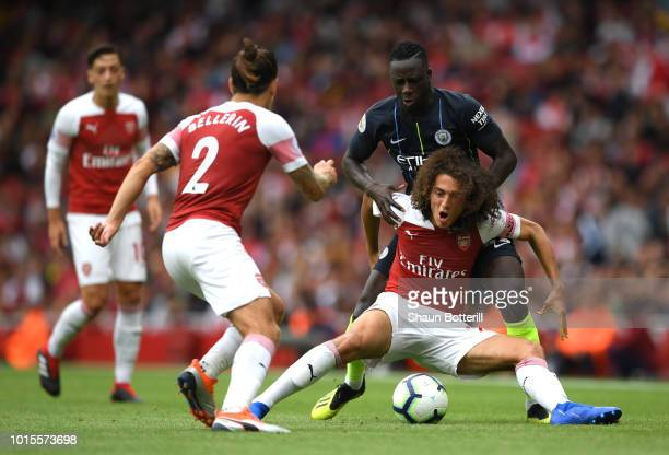 Benjamin Mendy of Manchester City challenges Matteo Guendouzi of Arsenal during the Premier League match between Arsenal FC and Manchester City at...