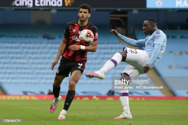 Benjamin Mendy of Manchester City clears from Dominic Solanke of Bournemouth during the Premier League match between Manchester City and AFC...