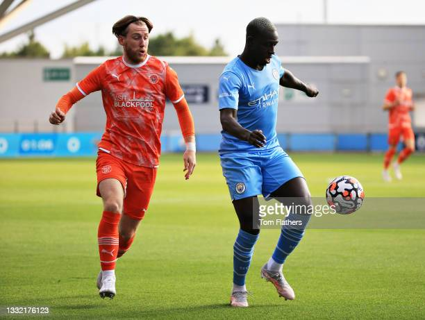 Benjamin Mendy of Manchester City controls the ball during the pre-season friendly match between Manchester City and Blackpool at Manchester City...