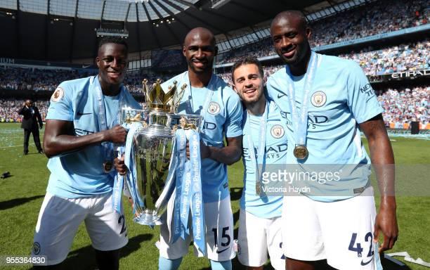 Benjamin Mendy of Manchester City Eliaquim Mangala of Manchester City Bernardo Silva of Manchester City and Yaya Toure of Manchester City celebrate...