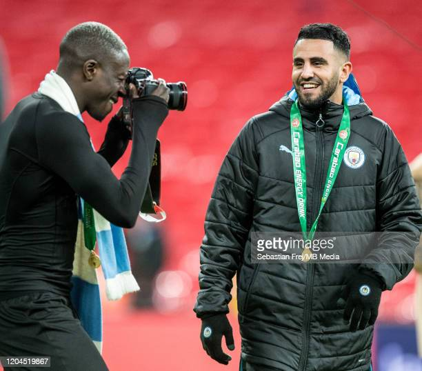 Benjamin Mendy of Manchester City holding camera and make pictures of hes team mate Riyad Mahrez during the Carabao Cup Final between Aston Villa and...