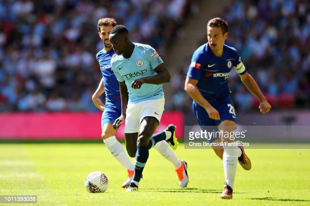 Benjamin Mendy of Manchester City is challenged by Cesar Azpilicueta of Chelsea during the FA Community Shield match between Manchester City and...