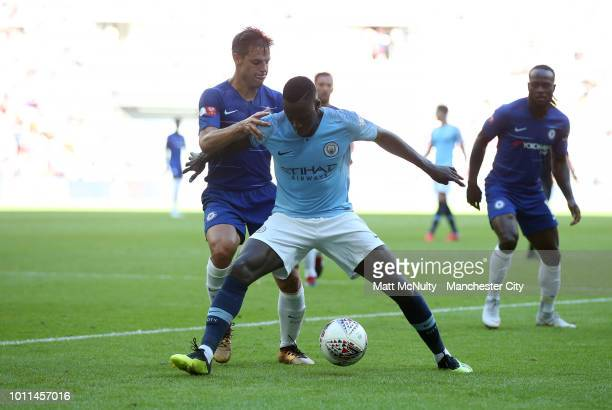 Benjamin Mendy of Manchester City is challenged by Cesar Azpilicueta of Chelsea during the FA Community Shield between Manchester City and Chelsea at...