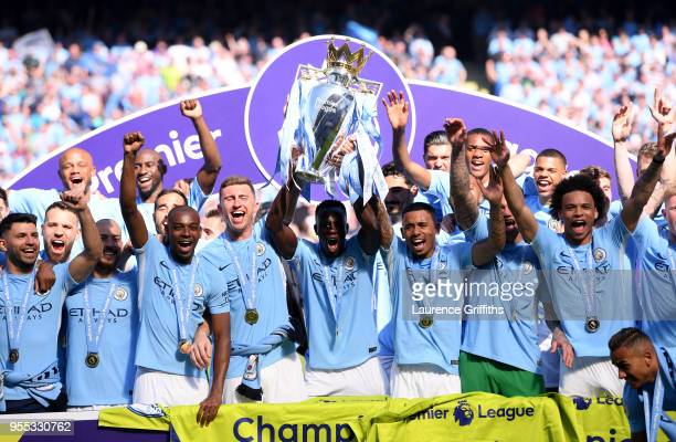 Benjamin Mendy of Manchester City lifts The Premier League Trophy after the Premier League match between Manchester City and Huddersfield Town at...