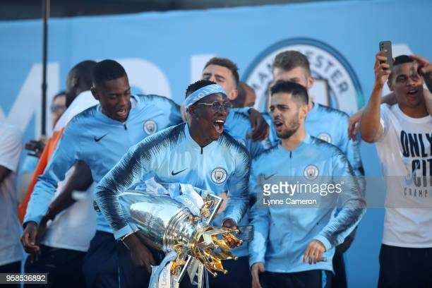 Benjamin Mendy of Manchester City lifts the Premier League Trophy during the Manchester City Trophy Parade in Manchester city centre on May 14 2018...