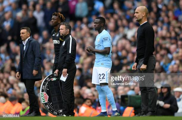 Benjamin Mendy of Manchester City looks on ahead being substituted onto the pitch during the Premier League match between Manchester City and Swansea...