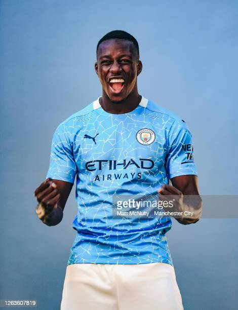 Benjamin Mendy of Manchester City poses wearing the 2020/21 Puma home jersey at the City Football Academy on August 03, 2020 in Manchester, England.