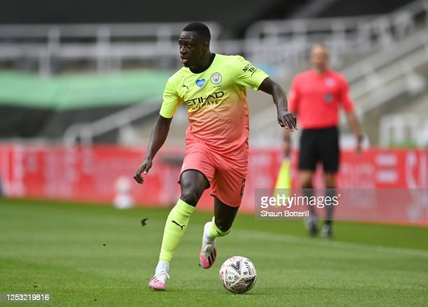 Benjamin Mendy of Manchester City runs with the ball during the FA Cup Quarter Final match between Newcastle United and Manchester City at St James...