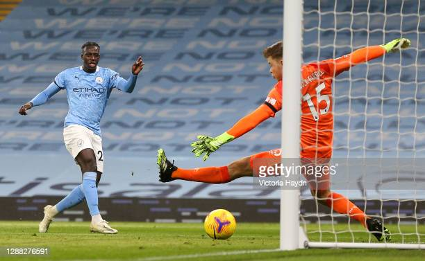 Benjamin Mendy of Manchester City scores his team's third goal past Bailey Peacock-Farrell of Burnley during the Premier League match between...