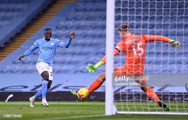Benjamin Mendy of Manchester City scores their team's third goal past Bailey Peacock-Farrell of Burnley during the Premier League match between...