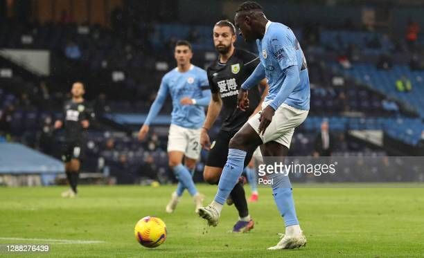 Benjamin Mendy of Manchester City scores their team's third goal during the Premier League match between Manchester City and Burnley at Etihad...
