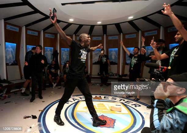 Benjamin Mendy of Manchester City sings in the dressing room following Manchester City's victory in the Carabao Cup Final between Aston Villa and...