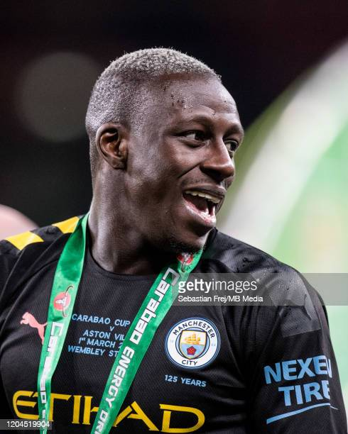 Benjamin Mendy of Manchester City smiles after winning the Carabao Cup Final between Aston Villa and Manchester City at Wembley Stadium on March 1...
