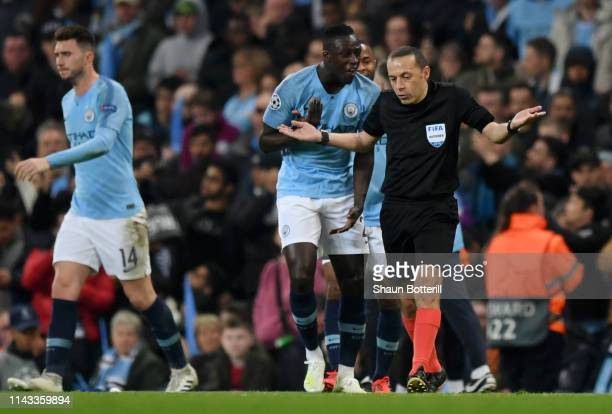 Benjamin Mendy of Manchester City speaks with Match Referee Cuneyt Cakir during the UEFA Champions League Quarter Final second leg match between...