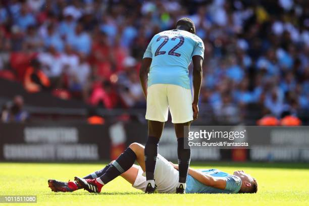 Benjamin Mendy of Manchester City stans over teammate Aymeric Laporte during the FA Community Shield match between Manchester City and Chelsea at...