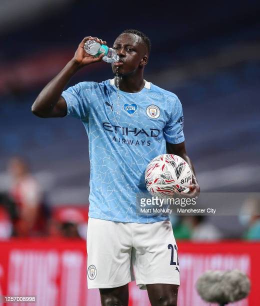 Benjamin Mendy of Manchester City takes a drink during the FA Cup Semi Final match between Arsenal and Manchester City at Wembley Stadium on July 18...
