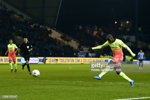 Benjamin Mendy of Manchester City takes a shot which hits the cross bar during the FA Cup Fifth Round match between Sheffield Wednesday and...