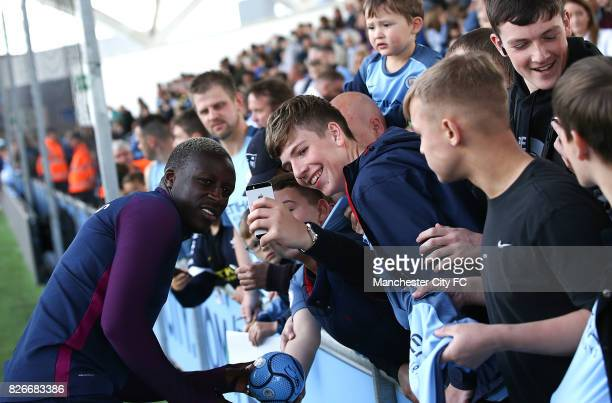 Benjamin Mendy poses for a picture with fans during the Cityzens Saturday at Etihad Stadium on August 5 2017 in Manchester England