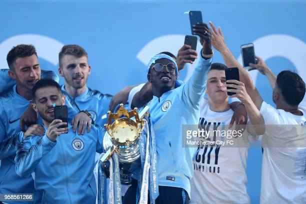 Benjamin Mendy poses with the Premier League trophy during the Manchester City Trophy Parade on May 14 2018 in Manchester England