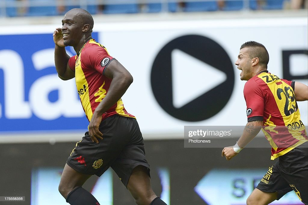 Benjamin Mokulu of KV Mechelen celebrates scoring a goal with teammate Alessandro Cordaro of KV Mechelen during the Jupiler League match between KAA Gent and KV Mechelen on August 04, 2013 in the Ghelamco stadium Gent, Belgium. (Photo by Nico Vereecken / Photonews