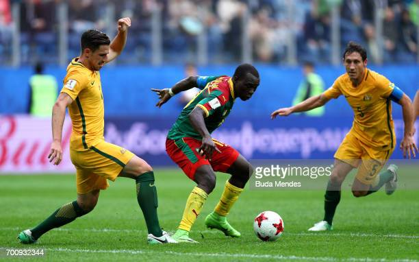 Benjamin Moukandjo of Cameroon goes past Mark Milligan of Australia during the FIFA Confederations Cup Russia 2017 Group B match between Cameroon and...
