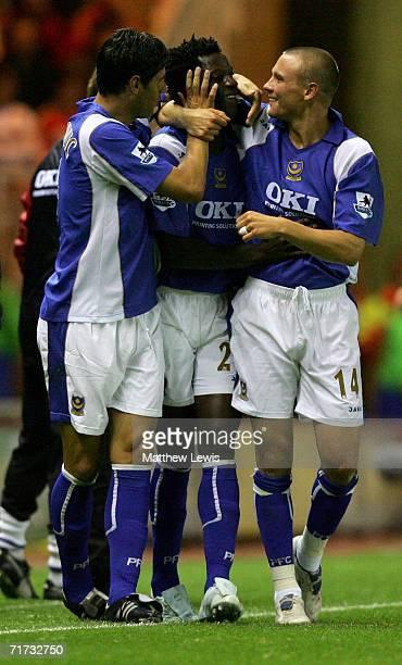 Benjamin Mwaruwari of Portsmouth celebrates scoring his team's second goal with team mates Dejan Stefanovic and Matt Taylor during the Barclays...