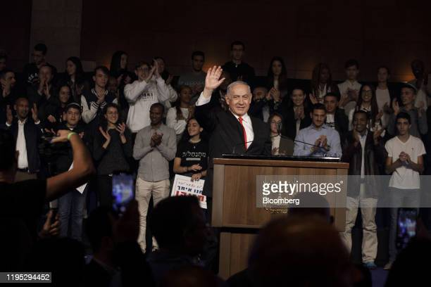 Benjamin Netanyahu Israel's prime minister acknowledges the audience during a campaign rally for his Likud party in Jerusalem Israel on Tuesday Jan...