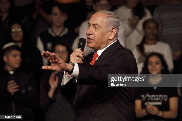 Benjamin Netanyahu Israel's prime minister gestures as he speaks during a campaign rally for his Likud party in Jerusalem Israel on Tuesday Jan 21...