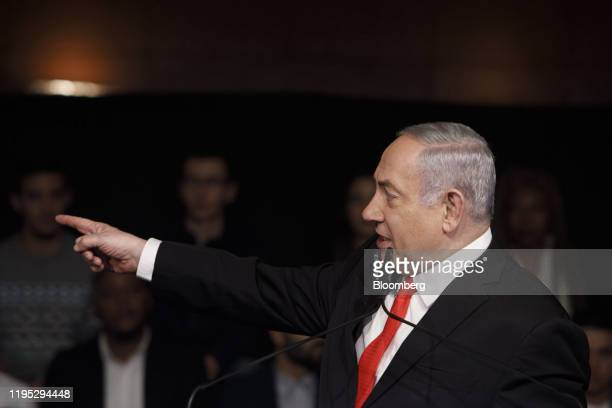 Benjamin Netanyahu Israel's prime minister points while speaking during a campaign rally for his Likud party in Jerusalem Israel on Tuesday Jan 21...