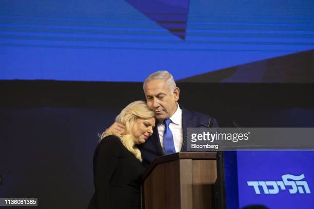 Benjamin Netanyahu, Israel's prime minister, right, embraces his wife Sara Netanyahu at the Likud party headquarters in Tel Aviv, Israel, early on...