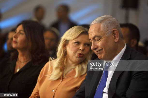 Benjamin Netanyahu, Israel's prime minister, speaks with wife Sara Netanyahu during an event marking the anniversary of the 1929 killing of 67 Jews...