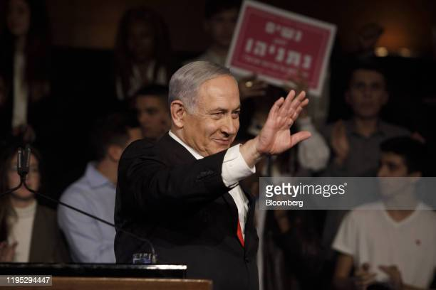 Benjamin Netanyahu Israel's prime minister waves to the audience during a campaign rally for his Likud party in Jerusalem Israel on Tuesday Jan 21...