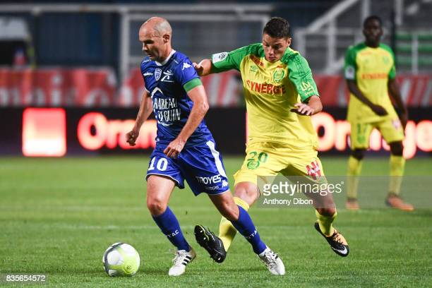 Benjamin Nivet of Troyes and Andrei Girotto of Nantes during the Ligue 1 match between Troyes Estac and FC Nantes at Stade de l'Aube on August 19...