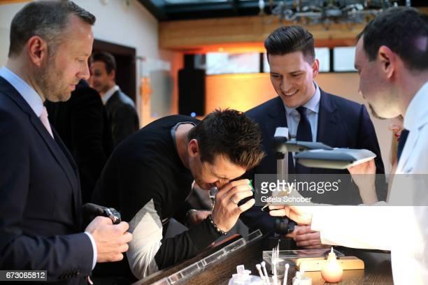 Benjamin P Sales Manager Glashuette Original Miroslav Klose and Peter Leuschner Brand Manager Deutschland Glashuette Original during the piano night...