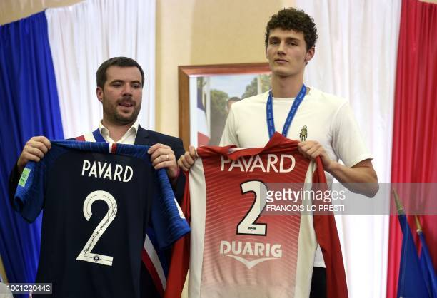 Benjamin Pavard and Jeumont's mayor Benjamin SaintHuile hold Pavard's France national team's jersey and his Jeumont club's jersey at the townhall in...