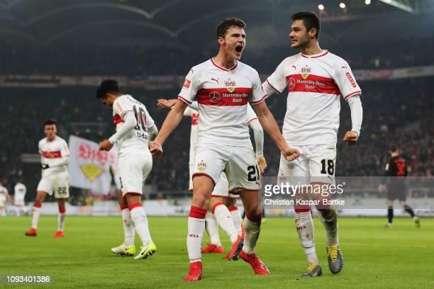 Benjamin Pavard and Ozan Kabak of VfB Stuttgart celebrate their team scoring the second goal of the game by Daniel Didavi during the Bundesliga match...