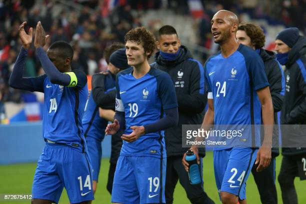 Benjamin Pavard defender and Steven Nzonzi midfielder of France team congratul the supporters after the friendly match between France and Wales at...