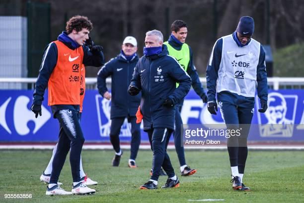 Benjamin Pavard Didier Deschamps head coach of France Raphael Varane and Steve Mandanda of France during training session at Centre National du...