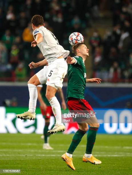 Benjamin Pavard of Bayern Munich battles for possession with Anton Miranchuk of Lokomotiv Moscow during the UEFA Champions League Group A stage match...