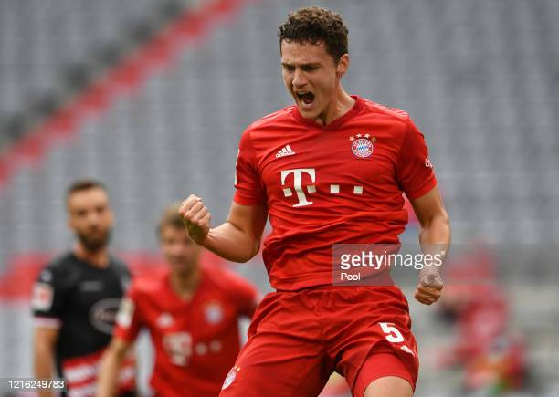 Benjamin Pavard of Bayern Munich celebrates after scoring his team's second goal during the Bundesliga match between FC Bayern Muenchen and Fortuna...