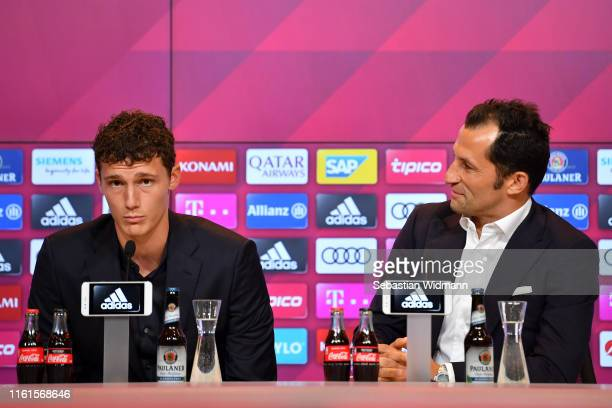 Benjamin Pavard of FC Bayern Muenchen and Hasan Salihamidzic sporting director of FC Bayern Muenchen talk to the media during a press conference to...
