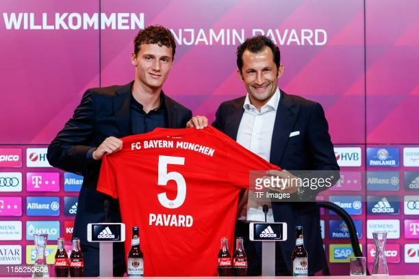 Benjamin Pavard of FC Bayern Muenchen and sporting director Hasan Salihamidzic of FC Bayern Muenchen look on during a press conference to announce...