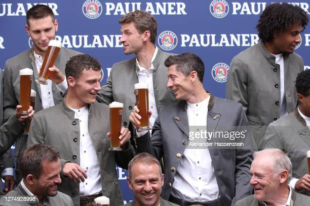 Benjamin Pavard of FC Bayern Muenchen attends with team mate Robert Lewandowski the FC Bayern Muenchen and Paulaner photo session at Nockherberg on...