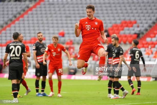 Benjamin Pavard of FC Bayern Muenchen celebrates after scoring his team's second goal during the Bundesliga match between FC Bayern Muenchen and...